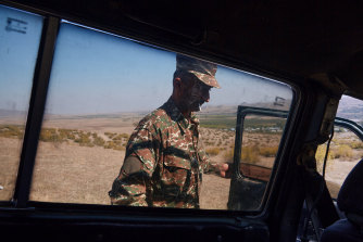 A soldier steps into his car on the outskirts of Askeran, Nagorno-Karabakh, Although Armenia lost part of the town of Hadrut to Azeri forces this week, the people of Nagorno-Karabakh continue to fight for autonomy over the contested territory.