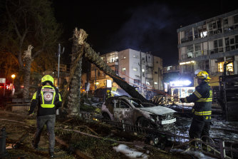 An Israeli firefighter works in the central Israeli town of Holon, where a rocket fired from the Gaza Strip hit.