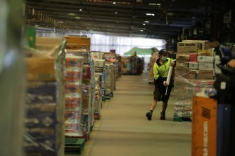 Workers at a Woolworths distribution centre in Larapinta, Brisbane.