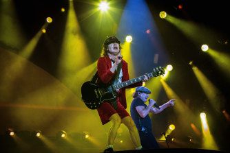 Angus Young on stage in Sydney with singer Brian Johnson, at the start of the band's Rock or Bust tour in 2015.