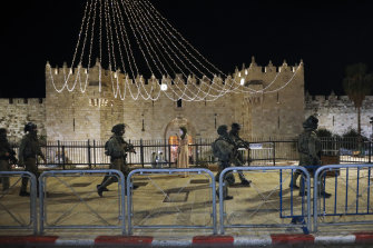 Israeli police officers deploy during clashes with Palestinian protesters next to Damascus Gate in Jerusalem's Old City on Friday.