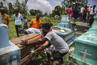 Francois Elmay is laid to rest in his family tomb in Les Cayes.