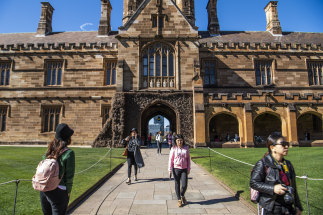 Students at the quadrangle building at the University of Sydney.