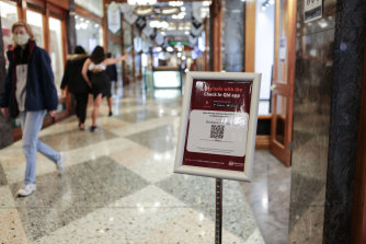 Check In Qld QR codes at the entrance to Brisbane Arcade in the CBD after an expansion of the platform's mandatory use from July 9.