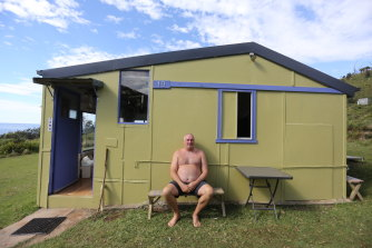 Gary McKenzie outside his shack at Little Garie Beach. His grandmother bought it in 1951, and it has survived a range of threats.