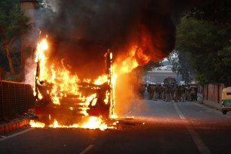 A bus goes up in flames during a protest against the Citizenship Amendment Act in New Delhi on Sunday.