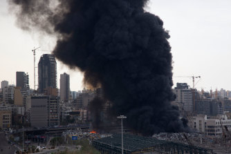 Smoke rises from a huge fire that broke out at Beirut's port on Thursday.