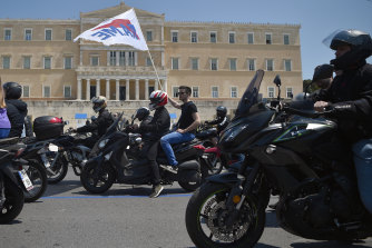 Tourism and delivery workers take part in a motorbike protest for International Memorial Day in front of the Greek Parliament on April 28 in Athens. The country is in coronavirus lockdown.
