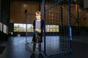 Elliot Daley, 9, has been playing in Brisbane Handball Club's junior competition for about six months and is excited about the chance for young Australians to represent their country at the 2032 Brisbane Olympics.