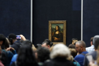 Tourists wait to see Leonardo da Vinci's painting Mona Lisa.