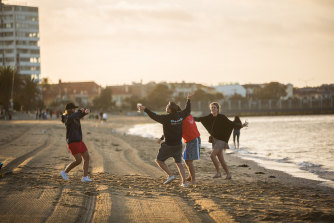 The party continues on St Kilda beach on Wednesday morning.