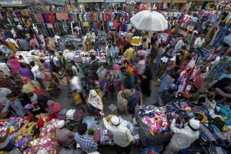 Indians throng a market for shopping ahead of Hindu festival Diwali in Ahmedabad. Officials are worried the festival will be a coronavirus superspreader event.
