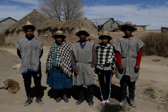Members of the Choque family, from left, Jose, Evarista Flores, Rufino, Abelina and Abdon, in the Urus del Lago Poopo indigenous community, in Punaca.