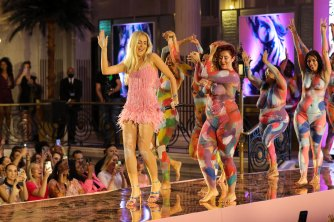 """British artist Sophie Tea leads body-painted models on a """"live Nudie catwalk"""" for her latest work, Women."""