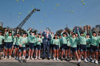 Tennis Australia's Craig Tiley with  Australian Open 2020 Kia ballkid squad members in Melbourne Park on Tuesday.