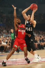Perth's Bryce Cotton defends against United's Chris Goulding.