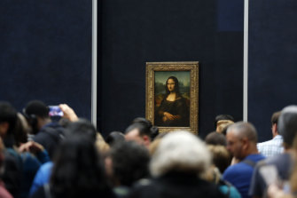 Tourists wait to see Leonardo da Vinci's painting Mona Lisa.