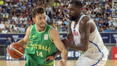 Hard yards: Boomer Angus Brandt takes on Philippines' Andray Blatche at Margaret Court Arena.