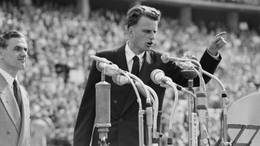 Evangelist Billy Graham speaks to over 100,000 Berliners at the Olympic Stadium in Berlin in 1954.