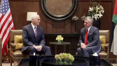 US Vice-President Mike Pence, left, meets with King Abdullah II at the Husseiniya Palace in Amman, Jordan, on Sunday.