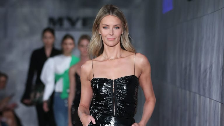 Jennifer Hawkins has vowed to stick by Myer, which posted a mammoth loss on Wednesday.