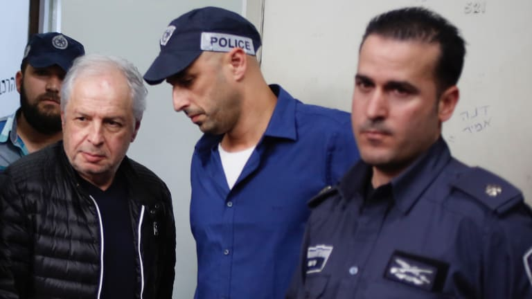 Bezeq telecom company's controlling shareholder Shaul Elovitch arrives to the magistrate court in Tel Aviv last month.