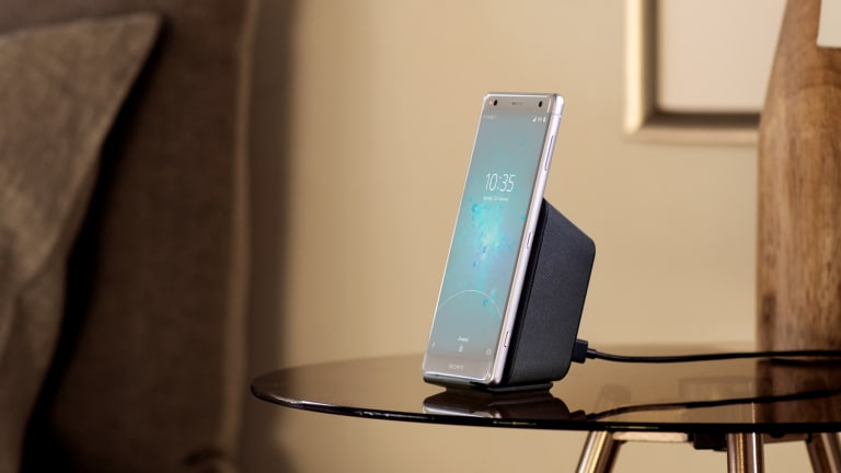 The Xperia XZ2, docked with Sony's sold-separately wireless charger.