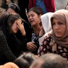 Frightened Kurds dig in, flee or bury their dead in the face of uncertainty