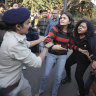 Indian police tried to beat up a protester. Then young women stepped in
