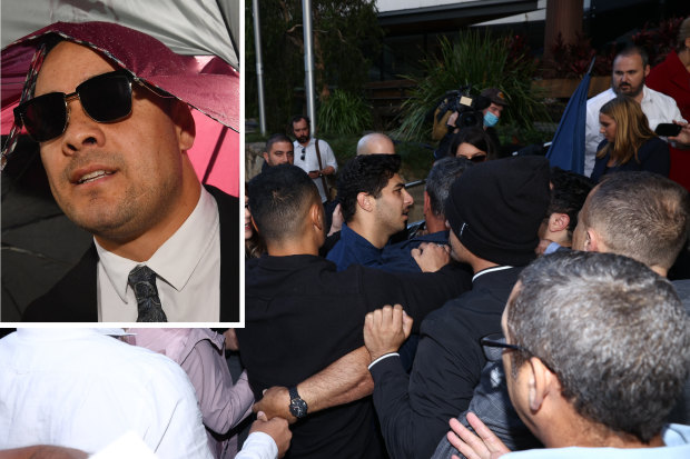 Jarryd Hayne's supporters were involved in a scuffle outside of a Newcastle court after the former NRL star was jailed on Thursday.