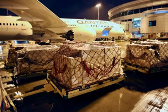 COVID-19 supplies for India being loaded into a Qantas plane earlier this week.