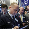 Wall Street posts record closes as investors digest trade news