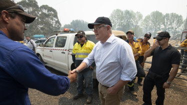 Prime Minister Scott Morrison meets NSW Rural Fire Service volunteers in the Blue Mountains on December 23.