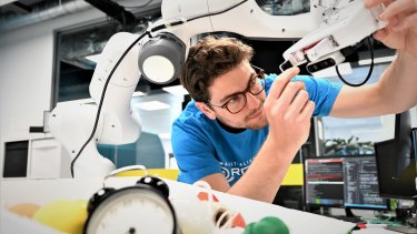 QUT PhD researcher Doug Morrison is teaching robots to grasp things like humans do.
