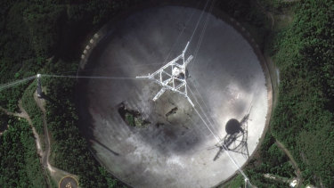 The damaged radio telescope at the Arecibo Observatory in Puerto Rico.