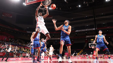 Moustapha Fall #93 of Team France dunks the ball over JaVale McGee #11 of Team United States.
