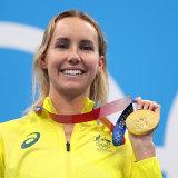 Emma McKeon celebrates Olympic gold.