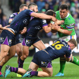 Josh Papalii appears to take on the entire Storm team in the qualifying final.