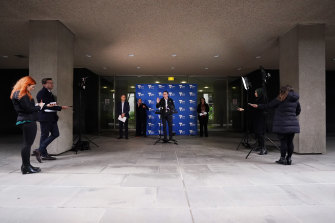 Premier Daniel Andrews addresses the media on Sunday.