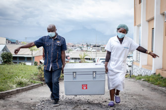 A shipment of COVAX AstraZeneca arrives in the Democratic Republic of Congo. Many poorer nations struggle to store and ship the doses they receive.