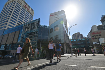 Pedestrians and shoppers in face masks at Bondi Junction earlier this week.