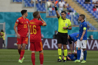 Wales' Ethan Ampadu sees red against Italy.