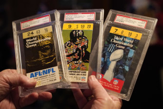 Crisman, one of three fans to have attended every Super Bowl, holds his tickets to the first three matches in the 1960s.