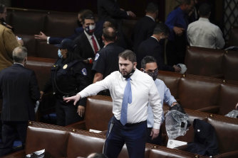 Democrat Ruben Gallego jumped on a chair to coordinate the evacuation from the House Chamber.