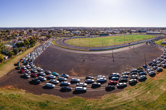 Aerial view of cars queuing for COVID-19 testing at Dubbo Showground on Friday.
