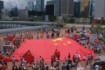 Beijing supporters display a Chinese flag to celebrate the 23rd anniversary of Hong Kong's return to Chinese rule and the new national security law in Hong Kong on Wednesday.
