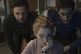Julia Garner plays a woman whose co-workers keep the boss' dirty secrets safe in The Assistant.
