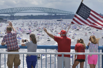 Trump supporters wave at hundreds of boats on the St Johns River in Florida to celebrate Trump's 74th birthday.
