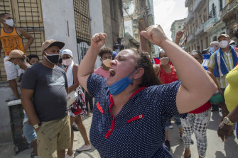 A woman shouts pro-government slogans as anti-government protesters march in Havana.