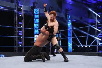 Former NRL player Daniel Vidot wrestles Sheamus on WWE Smackdown.